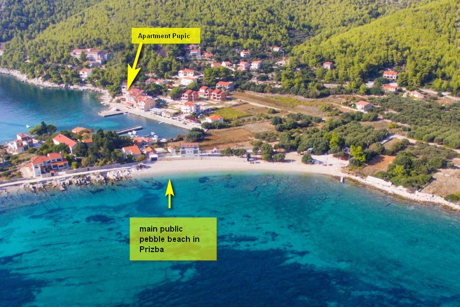 korcula-prizba-apartment-pupe-public-pebble-beach-01-flèche